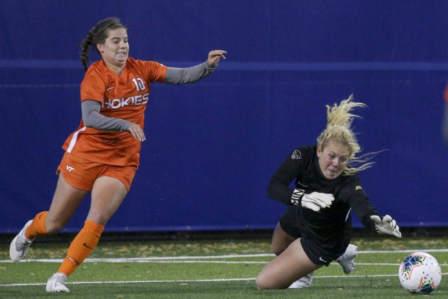 First-year goalkeeper Caitlyn Lazzarini (25) dives on the ball during Thursday evening's 1-0 loss to Virginia Tech.