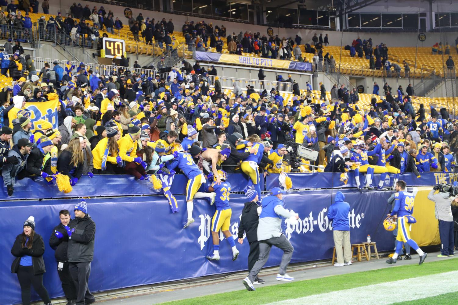 Pitt's players celebrate in the student section after beating North Carolina on Thursday night.