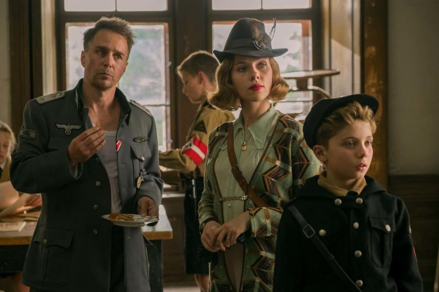 From left, Sam Rockwell, Scarlett Johansson and Roman Griffin Davis in a scene from the WWII satirical film