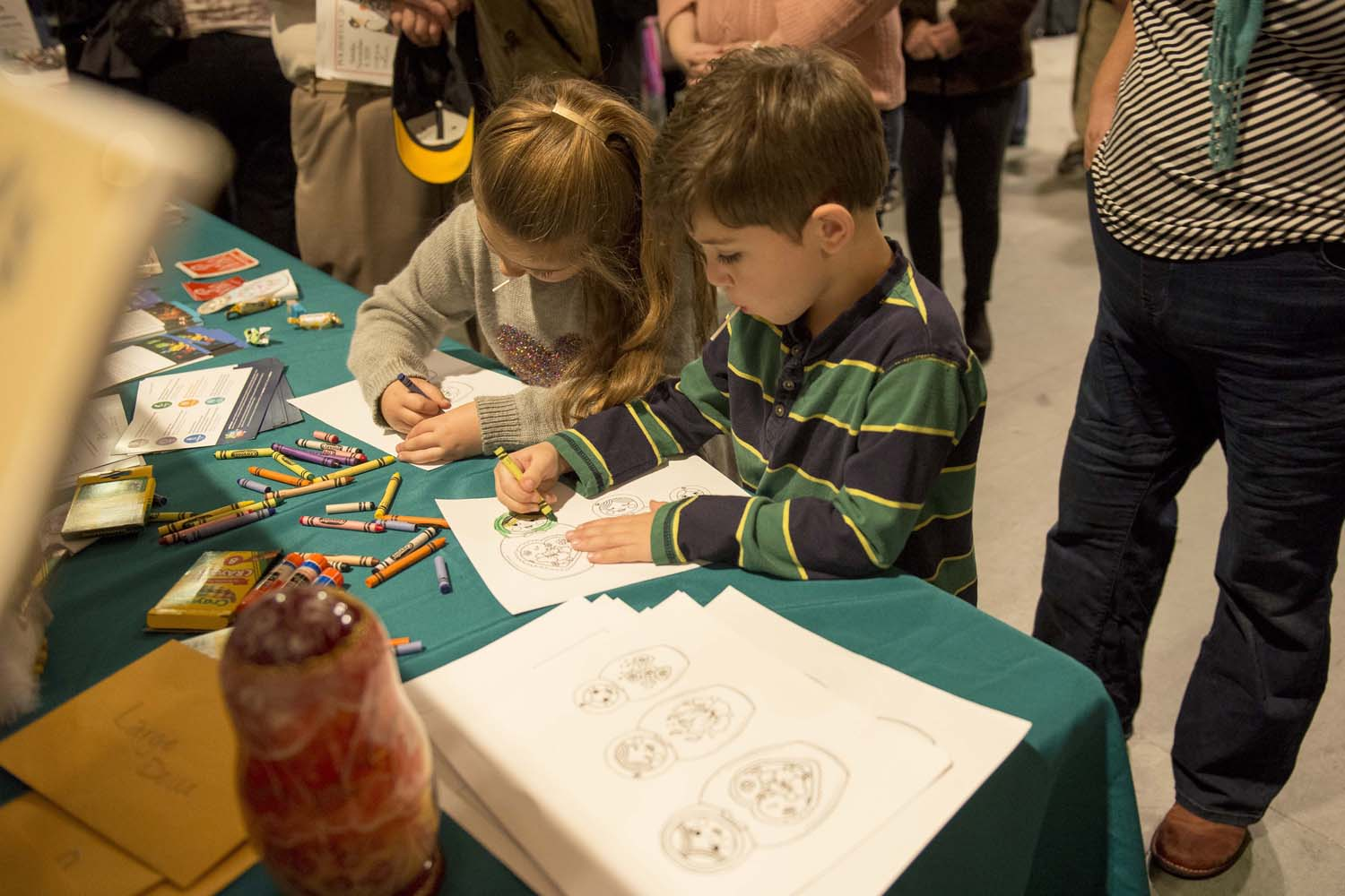Children color in images of nesting dolls at Sunday's Polish Festival in the Cathedral of Learning.