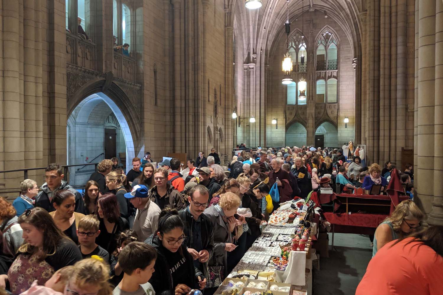 Vendors sell Christmas ornaments and other knickknacks in the Cathedral of Learning during the 29th annual Slovak Festival on Sunday.