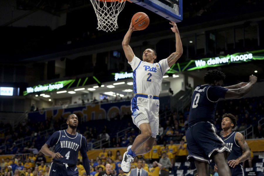 Sophomore guard Trey McGowens (2) goes up for a dunk during Pitt's 63-50 victory over Monmouth.
