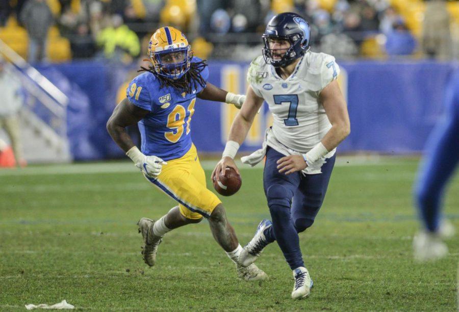 Patrick+Jones+II+%2891%29+pursues+a+sack+of+UNC+quarterback+Sam+Howell+%287%29.+