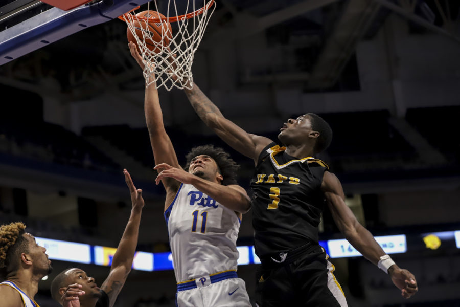 First-year+guard+Justin+Champagnie+%2811%29+led+Pitt%E2%80%99s+offense+with+21+points+during+the+Panthers%27+72-59+win+over+Northwestern.%0A