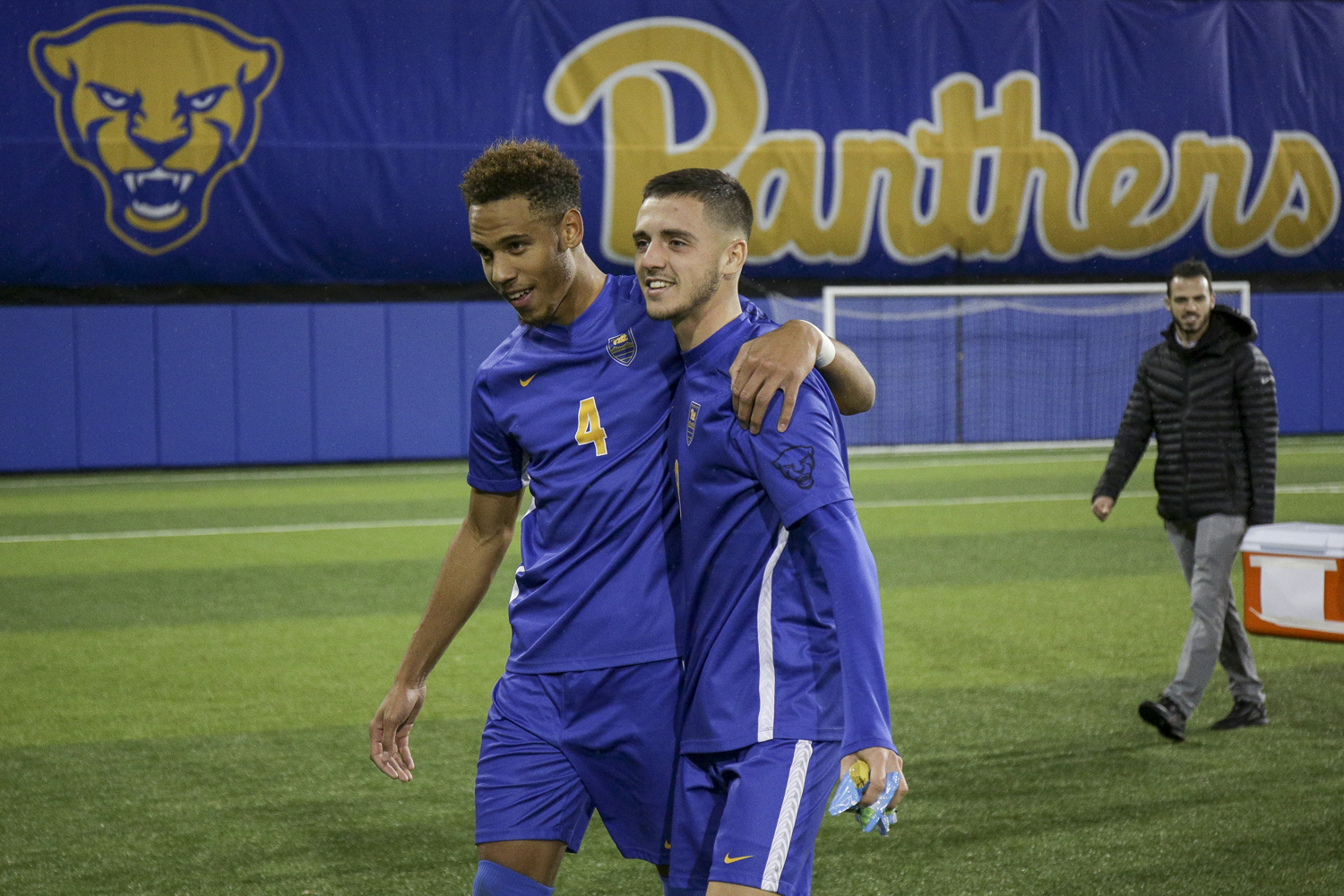 Junior Bryce Washington (4) and first-year Valentin Noel (8) walk off the field together after Pitt's 2-0 victory over Lehigh.