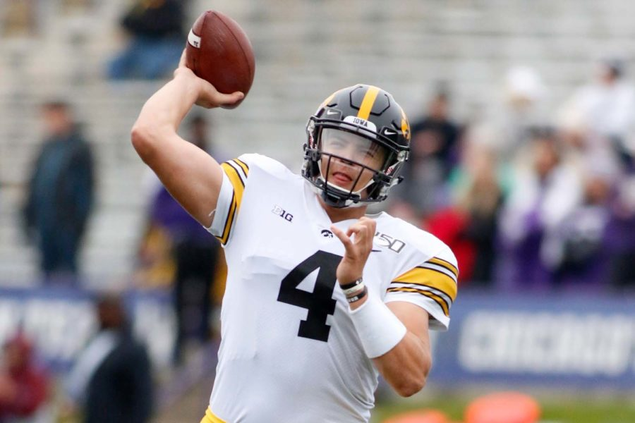 Nate Stanley (4) of the Iowa Hawkeyes warms up before a game against the Northwestern Wildcats.