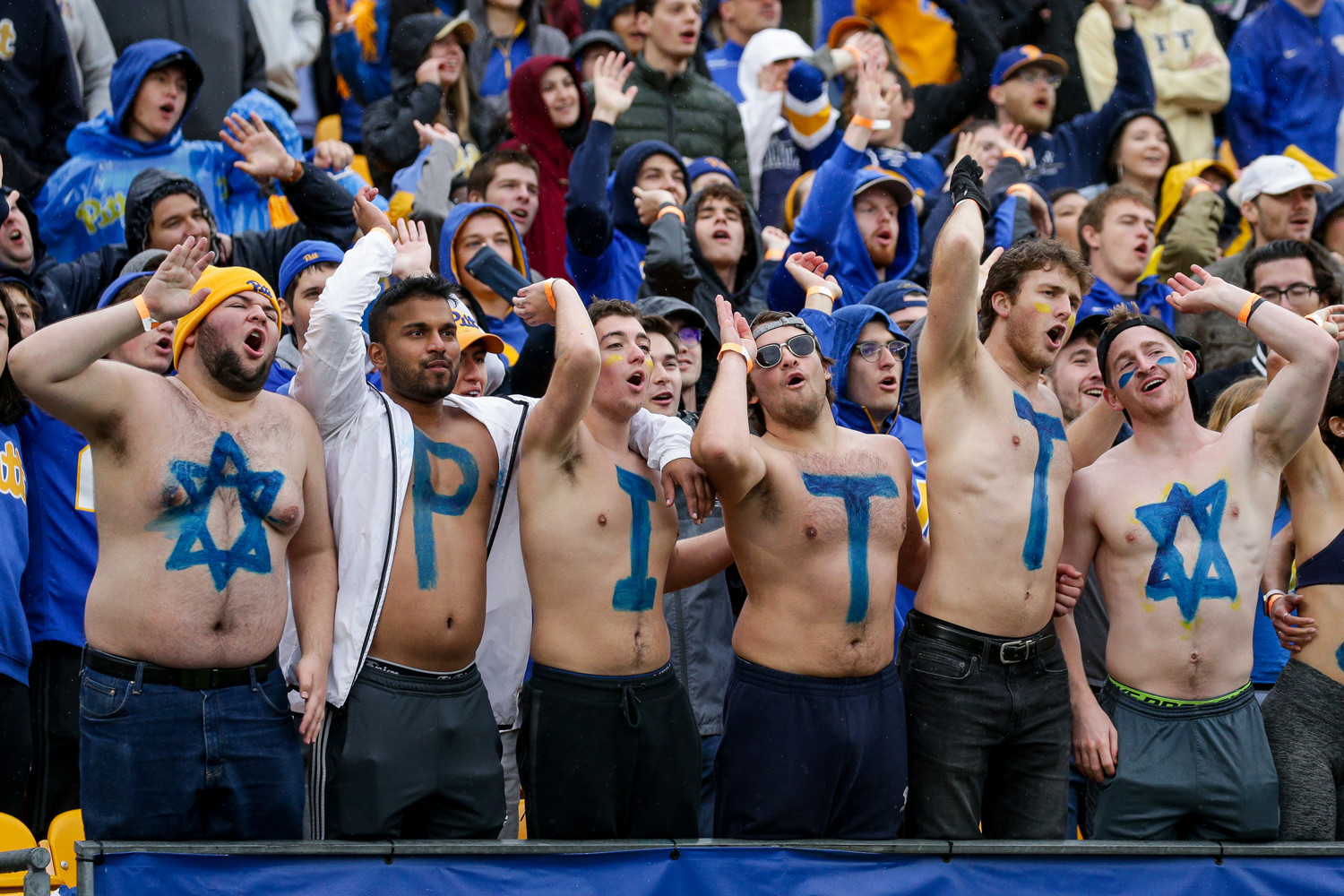 "Jonathan Perlman (far left), Pat Gardner (far right) and other students spelled ""Pitt Strong"" in body paint at an October football game against Miami to honor the Tree of Life victims."
