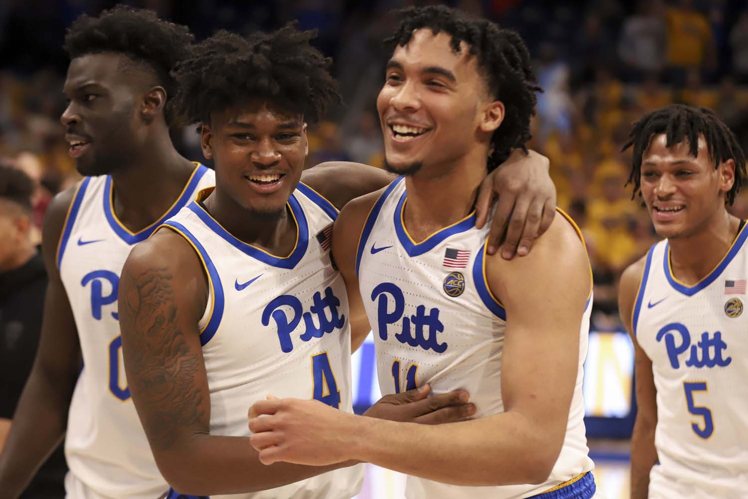First-year guards Gerald Drumgoole Jr. (4) and Justin Champagnie (11) celebrate after Wednesday's 63-61 victory over Florida State.