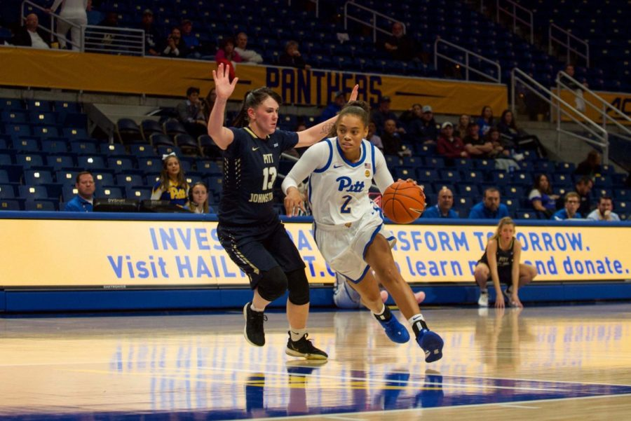 Redshirt senior guard Aysia Bugg rushes past Pitt-Johnstown's Alli McGrath. Bugg is one of only two current players who have seen regular starting minutes in their career.