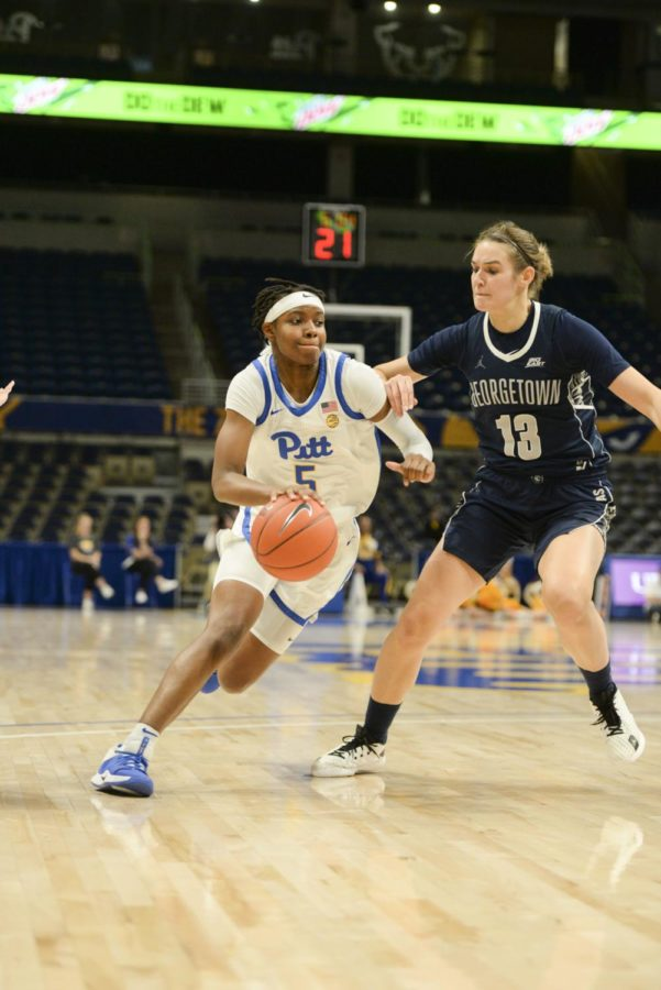 First-year guard Amber Brown pushes through Georgetown's defense.