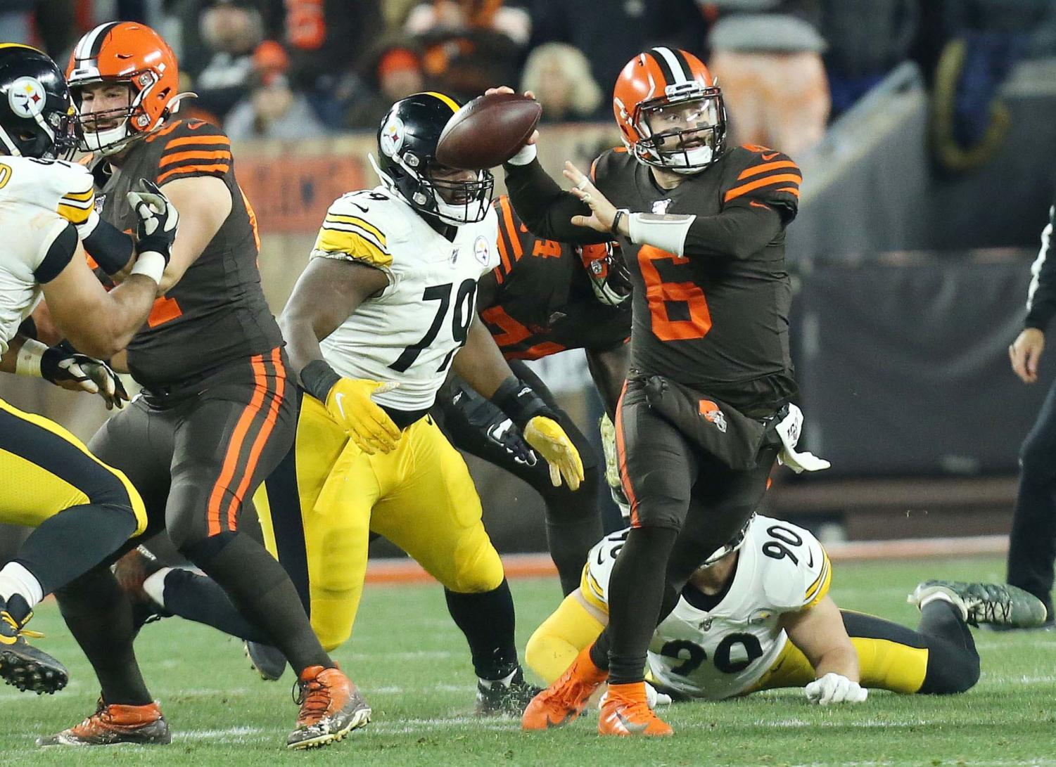 Cleveland Browns quarterback Baker Mayfield scrambles out of the pocket looking for a receiver in the first half, Nov. 14, 2019, at FirstEnergy Stadium.