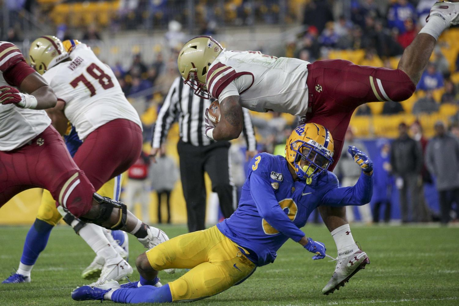 Senior safety Damar Hamlin (3) takes the Boston College halfback off his feet during Pitt's 26-19 loss to the Eagles.