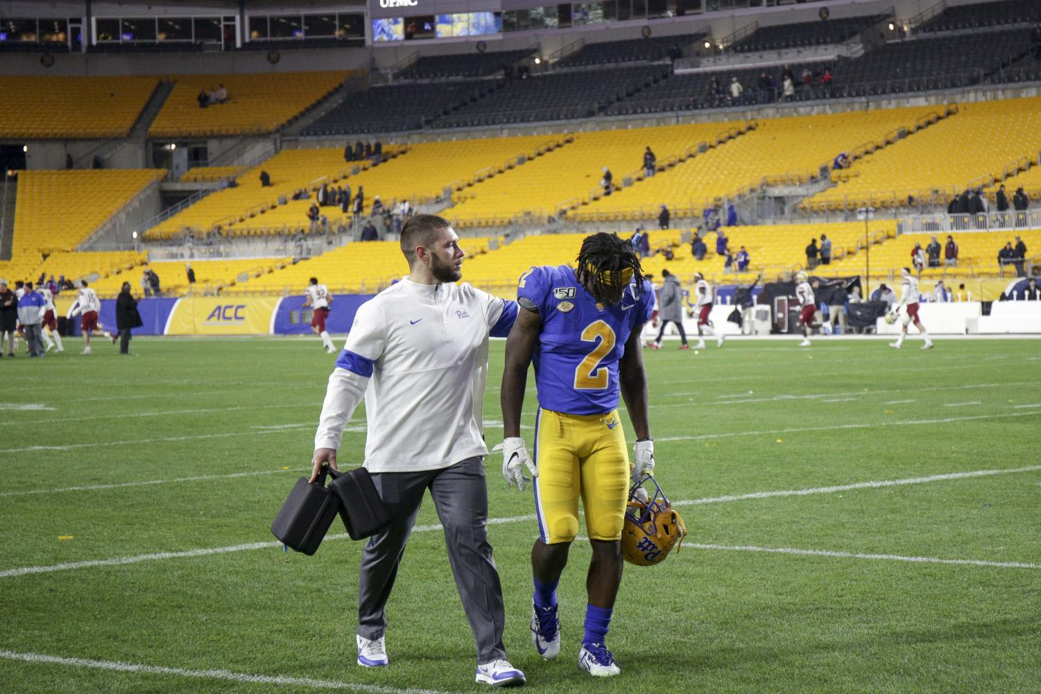 Senior Maurice Ffrench (2) walks off Heinz Field for the last time as a Pitt wide receiver.
