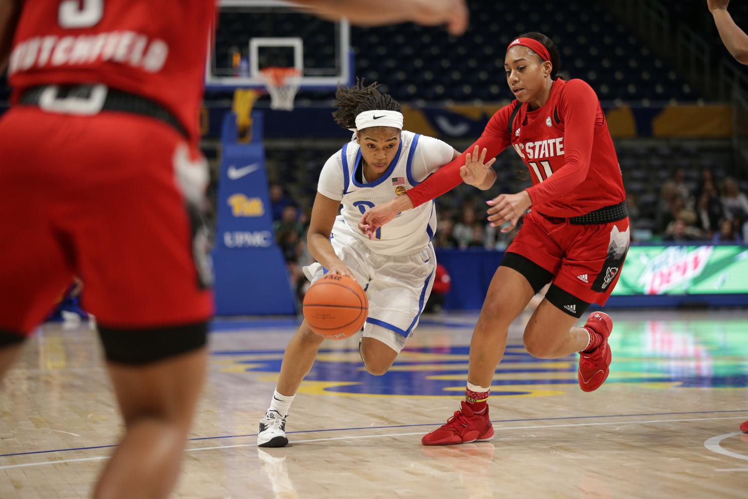First-year guard Dayshanette Harris (1) attempts to drive toward the hoop during Pitt's 88-44 loss to NC State.