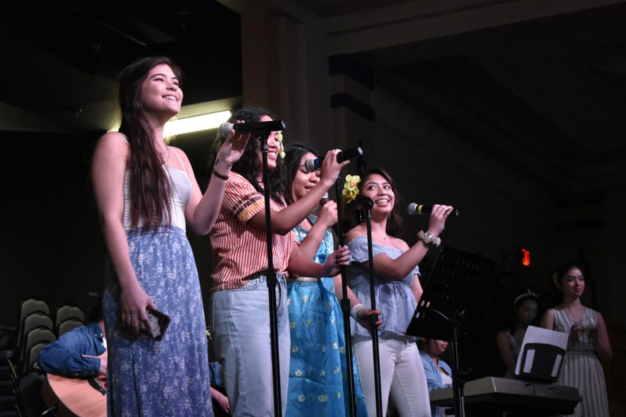 """The Filipino Student Association performs """"Hawak Kamay,"""" a Filipino pop song, during Saturday's Asian Student Alliance Culture Fair."""