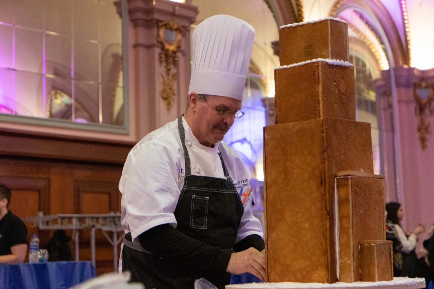 Chef Randolph Russell from Sodexo constructs a model Cathedral of Learning out of gingerbread.
