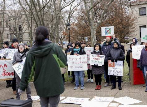 Demonstrators gather around Abhishek Viswanathan, a second-year PhD student studying Information Science, to listen to his speech about the importance of protesting in places like Pittsburgh as well as India against fascism.