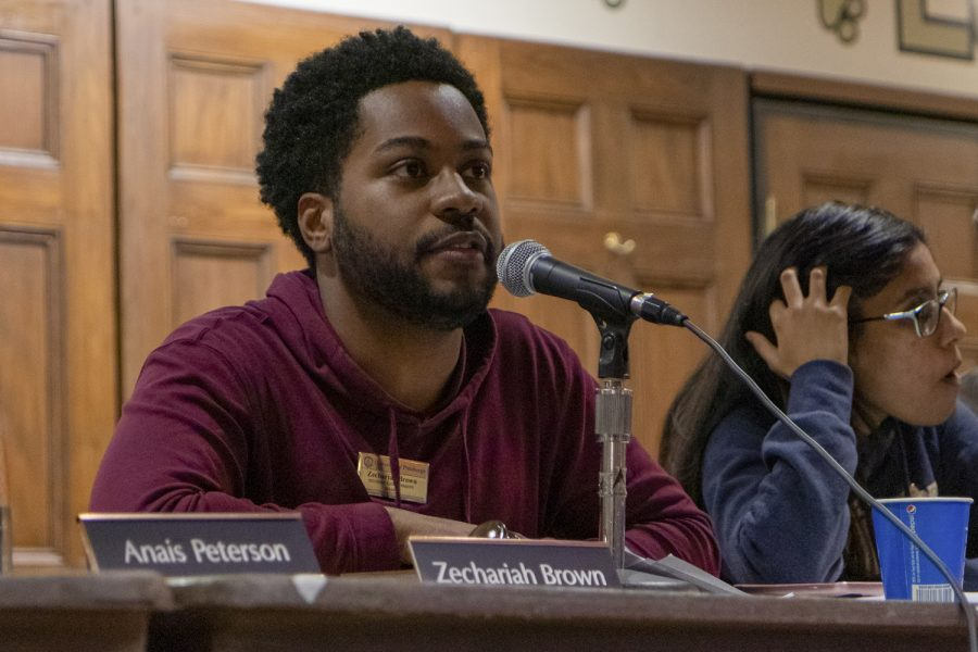 """SGB President Zechariah Brown discusses SORC's naming guidelines that will prohibit independent student organizations from using University trademarks like """"Pitt"""" and """"Panther"""" at Tuesday's weekly SGB meeting."""