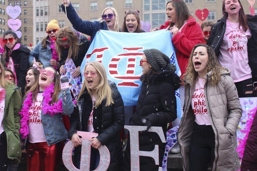 Delta Phi Epsilon members cheer on potential new members at Soldiers and Sailors Memorial Hall during Sunday's sorority Bid Day.