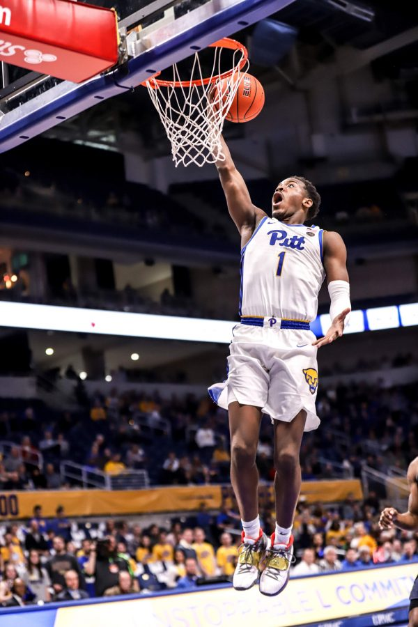 Sophomore guard Xavier Johnson (1) goes up for a dunk during Pitt's 87-79 victory over Canisius.