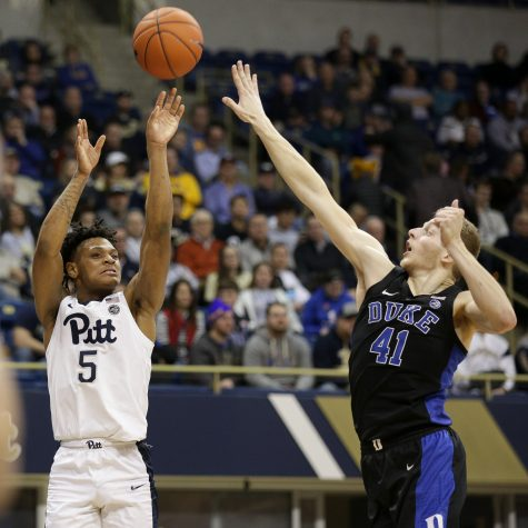Sophomore guard Au'Diese Toney (5) attempts a 3-pointer at last year's matchup with Duke at the Petersen Events Center.