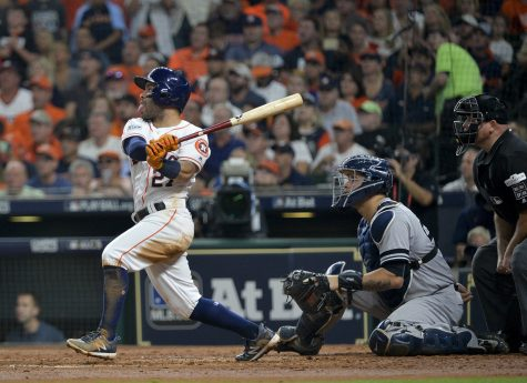 The Houston Astros' Jose Altuve hits a solo home run in the fifth inning against the New York Yankees in Game 7 of the American League Championship Series at Minute Maid Park in Houston on Oct. 21, 2017. The Astros won, 4-0, to advance to the World Series.