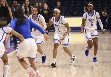 Pitt women's basketball celebrates after breaking a two-month losing streak with a win against Wake Forest.