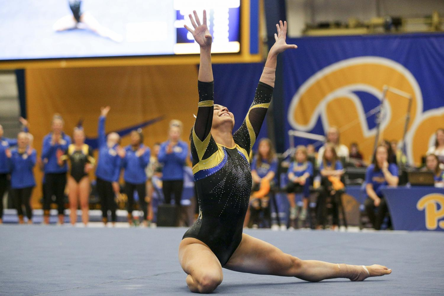 Senior Deven Herbine finishes her floor routine at Saturday's 194.225-193.800 loss to New Hampshire.