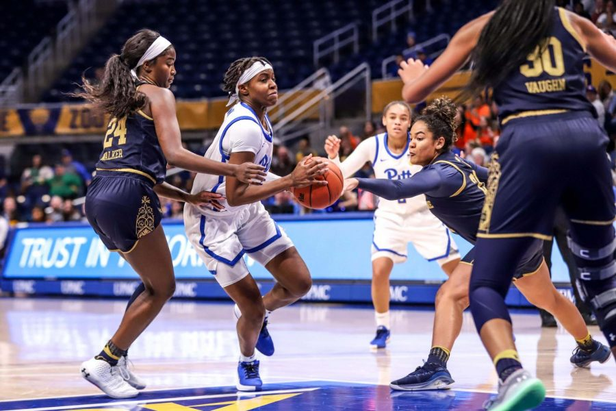 First-year guard Amber Brown attempts to push through Notre Dame's defense.