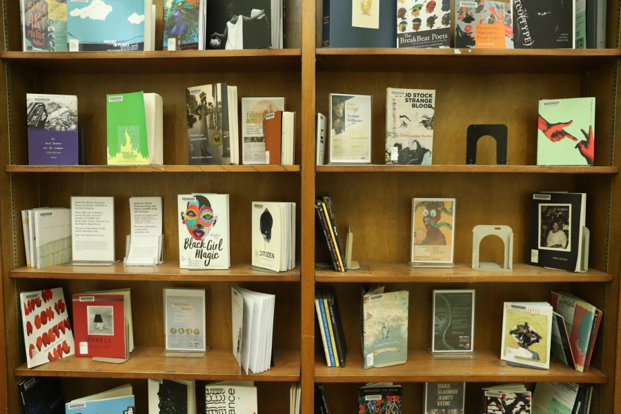Colorful+chapbooks+%E2%80%94+small+collections+of+poetry+centered+on+a+theme+%E2%80%94+line+the+featured+shelves+in+Hillman%E2%80%99s+new+African+American+poetry+exhibit.+The+featured+books+were+written+and+signed+by+black+poets+who+have+visited+Pitt%E2%80%99s+campus.+