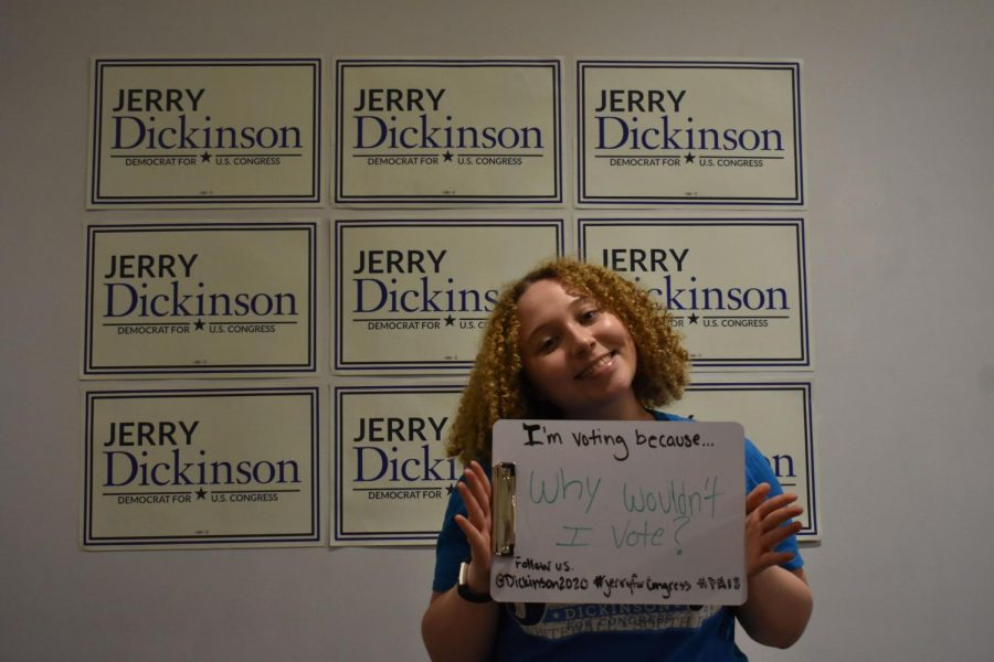 Pitt student Catherine Tomes holds a sign encouraging voting as a part of the Dickinson campaign.