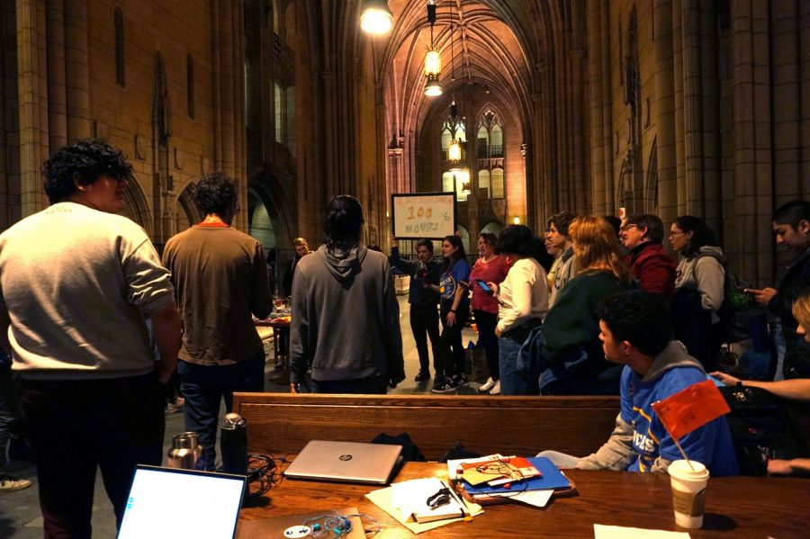 "Protesters sing the popular folk song ""We Shall Not Be Moved"" on Tuesday in the Cathedral to commemorate the 100th hour of the Fossil Free Pitt Coalition's sit-in with lyrics changed to be specific to the sit-in."