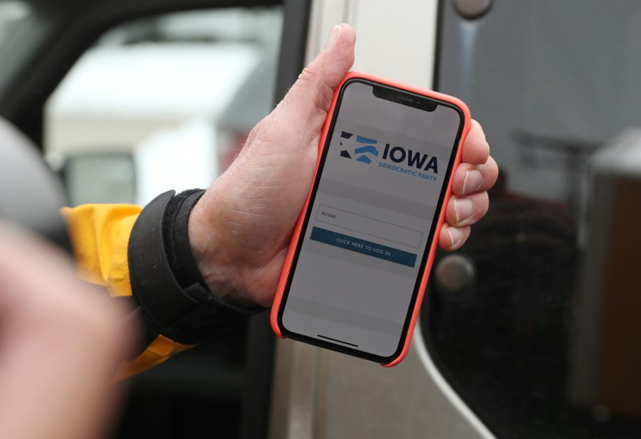 Carl Voss, chair of Des Moines' 55th precinct, displays the phone app he used to view Iowa caucus results, at the Iowa Democratic Party headquarters, Feb. 4, in Des Moines, Iowa.