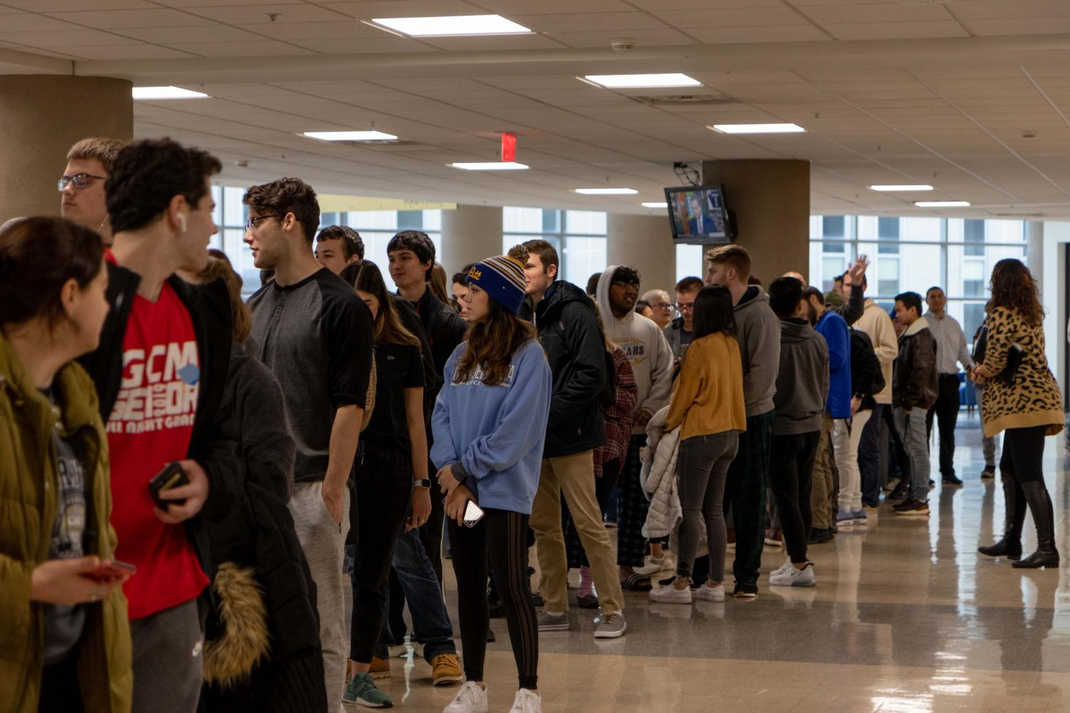 Students await the opening of the newly reopened Chick-fil-A.