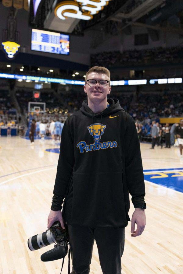 Alex Geiger serves as assistant director of creative content as a member of the Pitt men's basketball coaching staff.