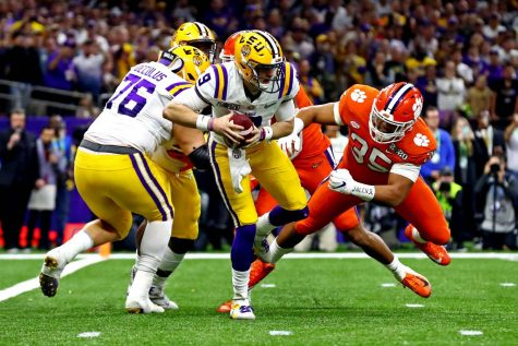 LSU quarterback Joe Burrow runs away from Clemson defensive end Justin Foster during the College Football Playoff final.