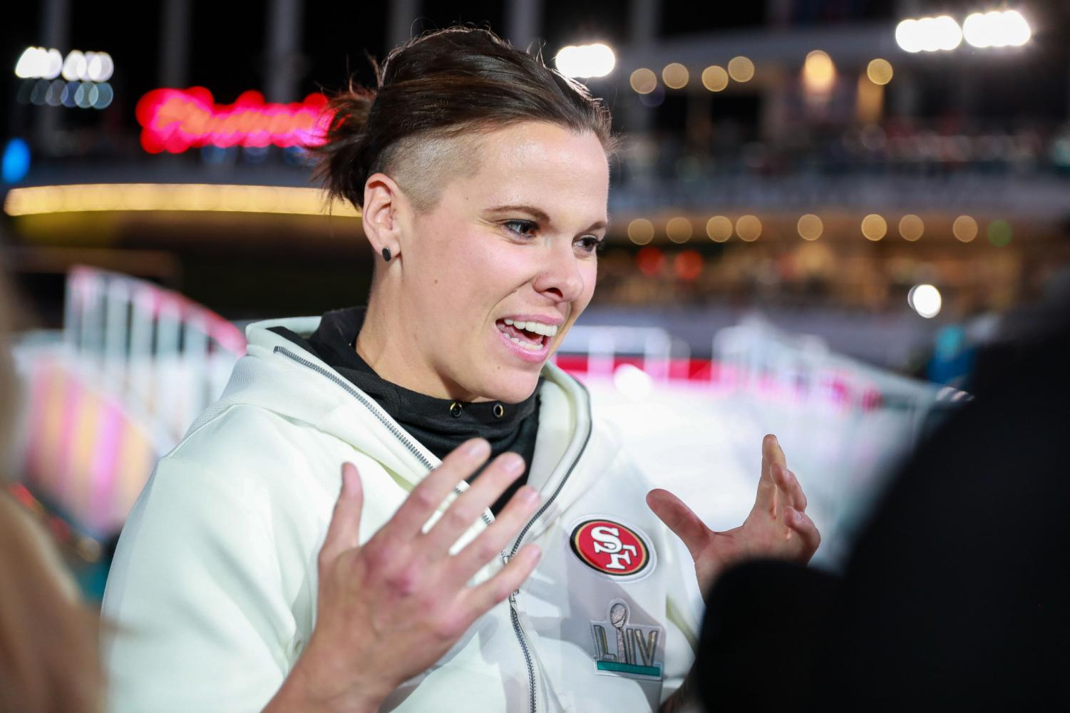 San Francisco 49ers' Offensive assistant coach Katie Sowers is seen at the Miami Marlins Park during Super Bowl opening night on Monday, Jan. 27.