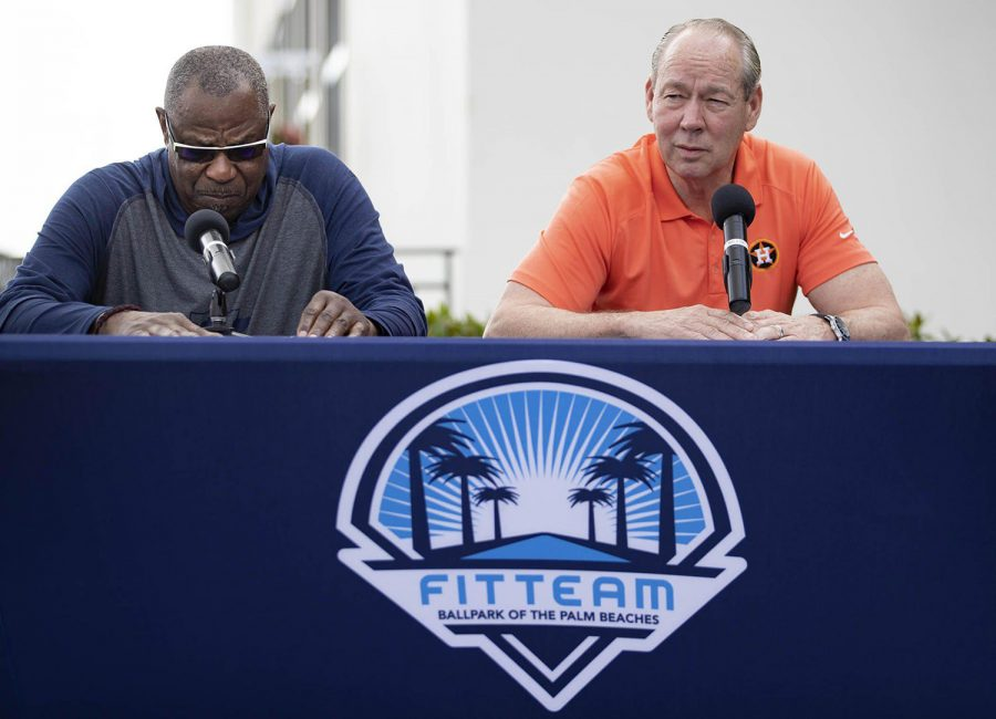 Houston Astros manager Dusty Baker, left, listens as team owner Jim Crane talks during a news conference before the start of spring training at Fitteam Ballpark of the Palm Beaches in West Palm Beach, Florida, on Thursday, Feb. 13.