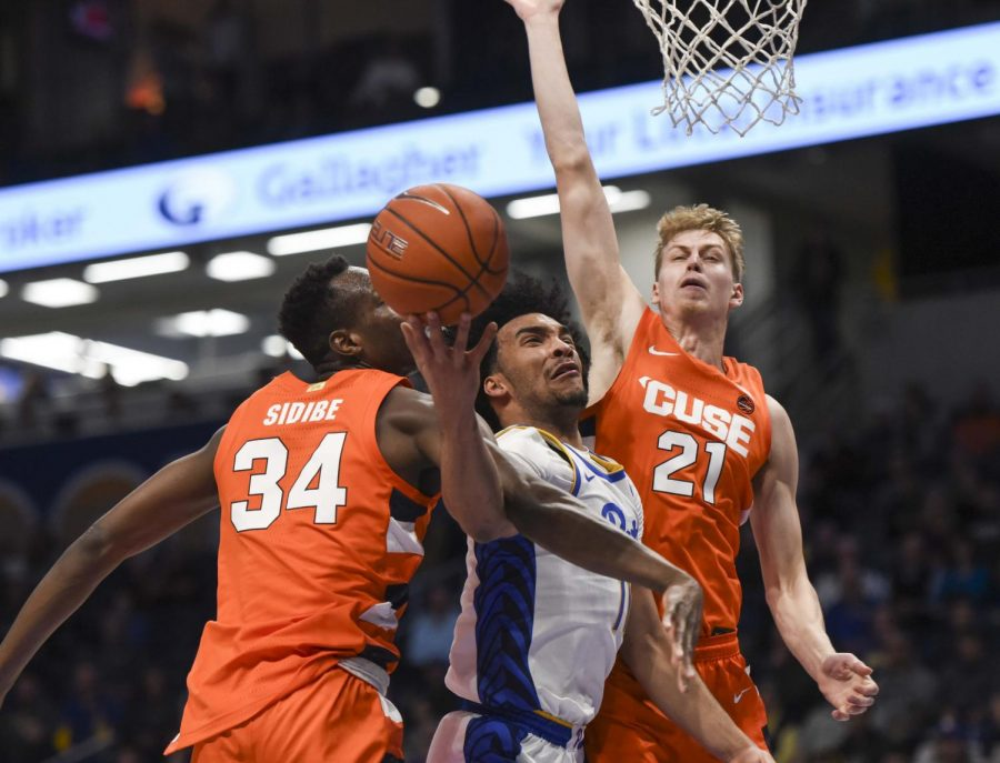 First-year forward Justin Champagnie's layup is blocked by Syracuse.