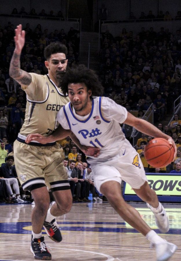 Champagnie dominates as Pitt defeats Duke, 79-73