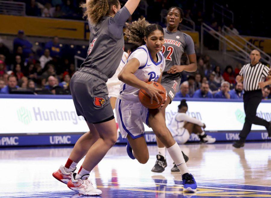 First-year guard Emy Hayford struggles to move around Louisville's Mykasa Robinson.
