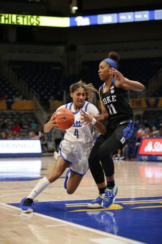 First-year guard Emy Hayford navigates around Duke's Azana Baines. Pitt lost to Syracuse Sunday 53-71.