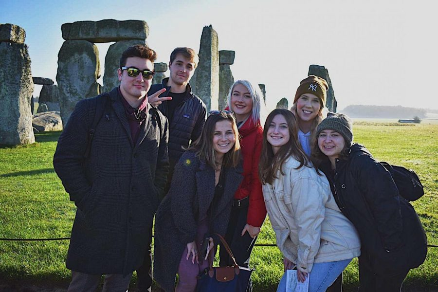Jess+Fisher%2C+third+from+left%2C+poses+at+Stonehenge+with+friends+from+her+building.+