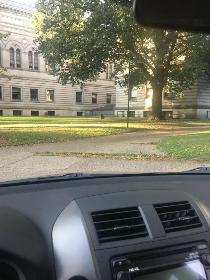 Staff writer Megan Williams sits outside the Carnegie Library in her car.