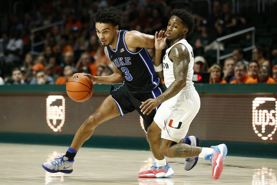 Duke's Tre Jones, left, drives against Miami's Chris Lykes during the second half at the Watsco Center on Jan. 4. Duke won, 95-62.