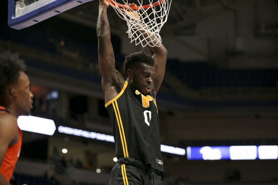 Graduate transfer forward Eric Hamilton dunks against Clemson. He led Pitt with 12 points against Georgia Tech Wednesday night.