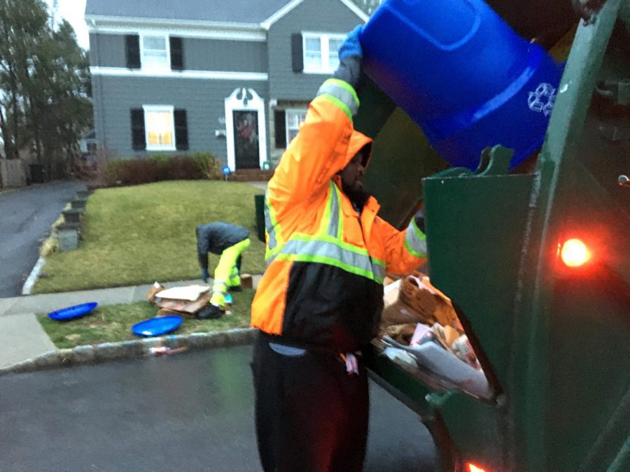 A garbage collector empties recyclables into a Basso Rubbish Removal truck in New Jersey. Garbage collection in Pittsburgh came to a standstill Wednesday morning after sanitation workers from the City held a demonstration insisting they were not receiving proper protective gear to continue working during the coronavirus pandemic.