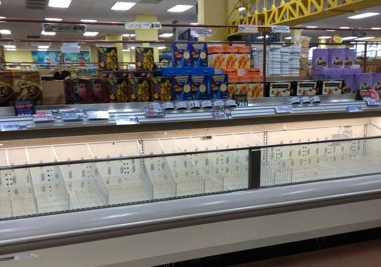 An+empty+freezer+section+at+Trader+Joe%E2%80%99s.+