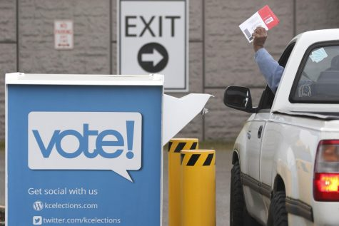 Voters drop off their presidential primary mail-in ballots at a drop box at King County Elections in Renton, Washington, on March 10.