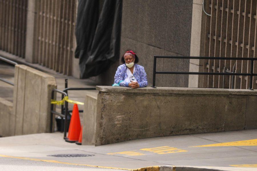A+hospital+worker+awaits+a+shuttle+outside+the+UPMC+Presbyterian+parking+garage.